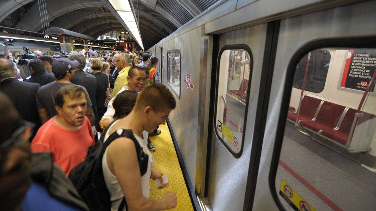 Riders wait for a subway train in Toronto on July 21, 2011.