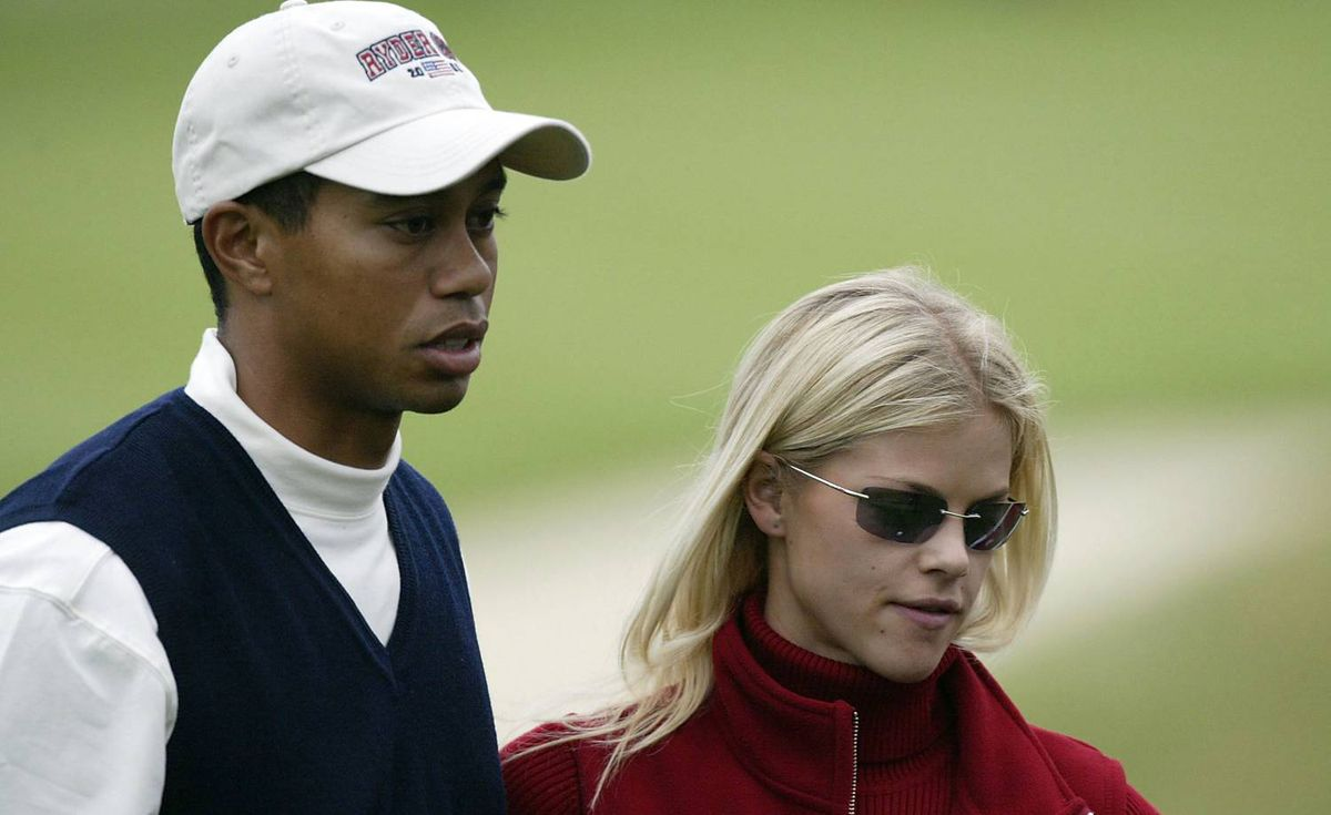 Tiger Woods and girlfriend Elin Nordegren on the 17th green after his defeat during the afternoon foursome matches on the first day of the 34th Ryder Cup at the De Vere Belfry in Sutton Coldfield, England on Sept. 27, 2002.