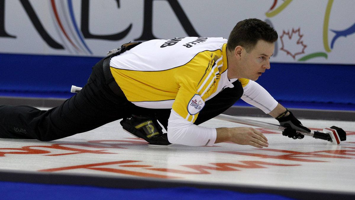 Manitoba skip Rob Fowler keeps his eye on his shot during an afternoon draw against Quebec at the Tim Hortons Brier in Saskatoon, Sask, Sunday, March, 3, 2012. THE CANADIAN PRESS/Jonathan Hayward