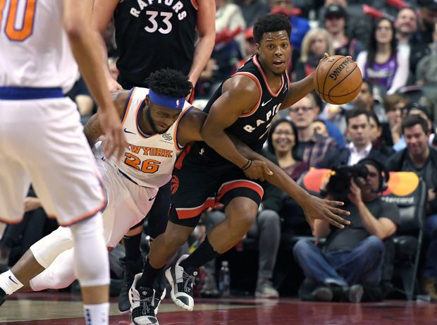 85c223c45 Open this photo in gallery. Toronto Raptors guard Kyle Lowry (7) battles for  a loose ball with New York Knicks ...
