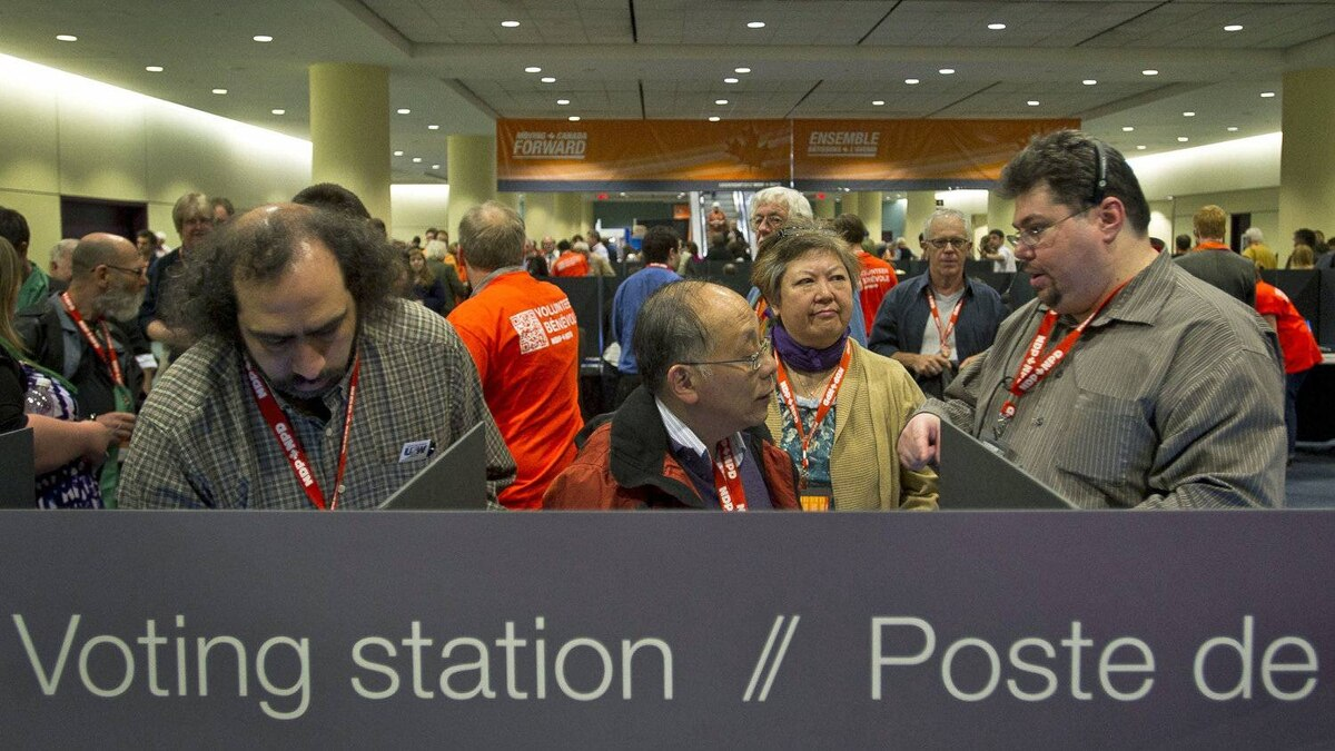 Delegates line up to vote as technical difficulties cause lengthy delays at the NDP leadership convention in Toronto on March 24, 2012.(