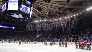 New York Rangers, right, celebrate their 3-1 win as the Washington Capitals skate off the ice after Game 1 in the second round of the NHL hockey Stanley Cup playoffs Saturday, April 28, 2012, in New York. (AP Photo/Frank Franklin II)