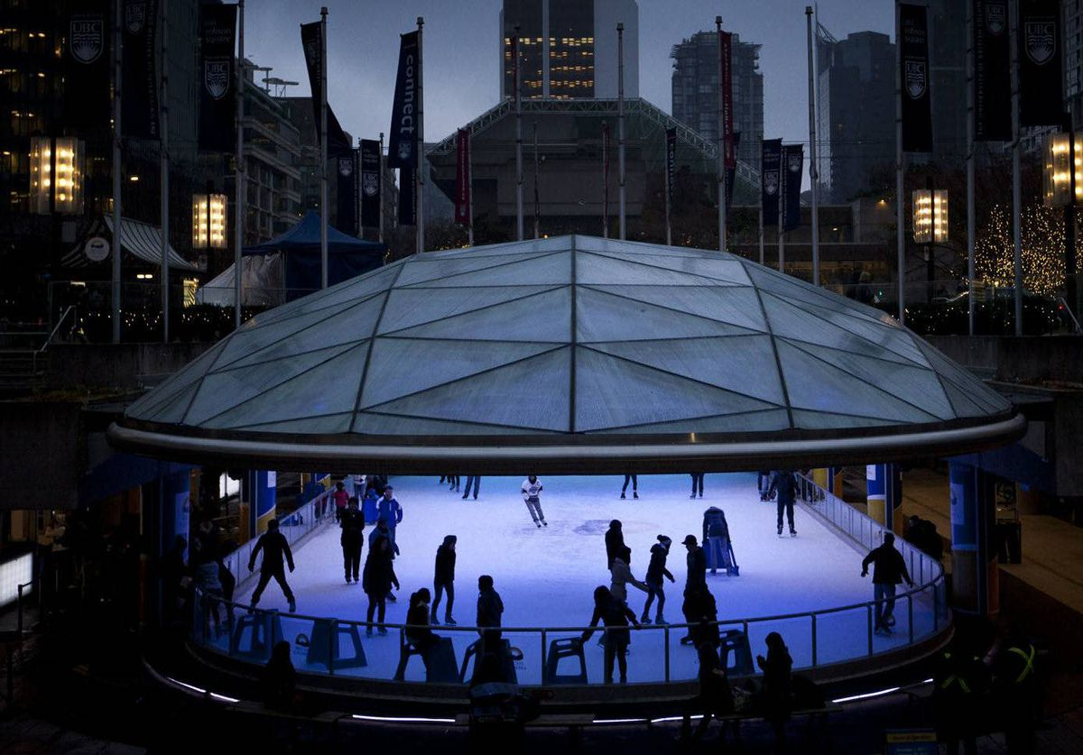 Skaters take to the ice at Robson Square in Vancouver.