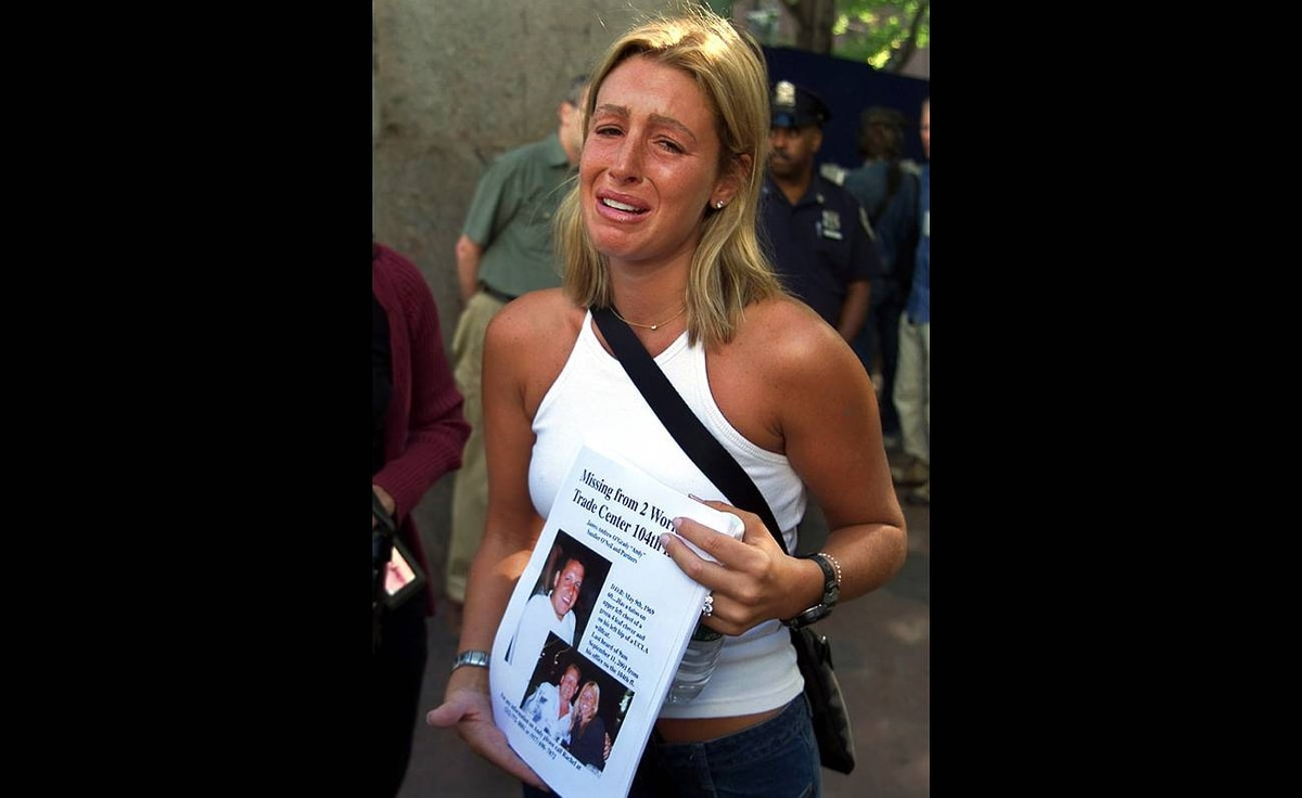 Rachel Uchitel makes an emotional plea as she searches for her fiance James Andrew O'Grady outside Bellevue Hospital Center in Manhattan on Thursday, Sept. 13, 2001. Mr. O'Grady was killed in the September 11 terrorist attack on the World Trade Center in New York. Ms. Uchitel has been linked to golfer Tiger Woods in a story in the National Enquirer. She denied having an affair him.