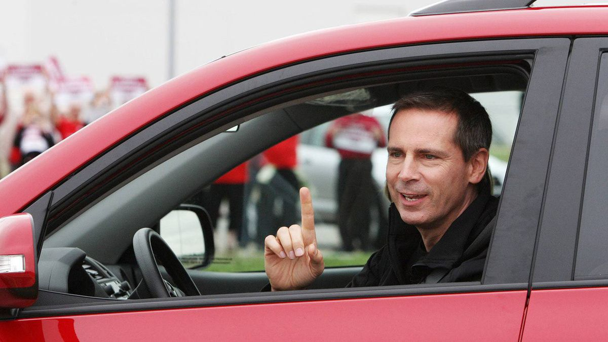 Ontario Premier Dalton McGuinty test drives a Toyota RAV4 vehicle at the Woodstock, Ont., assembly plant test-track on Sept. 8, 2011.