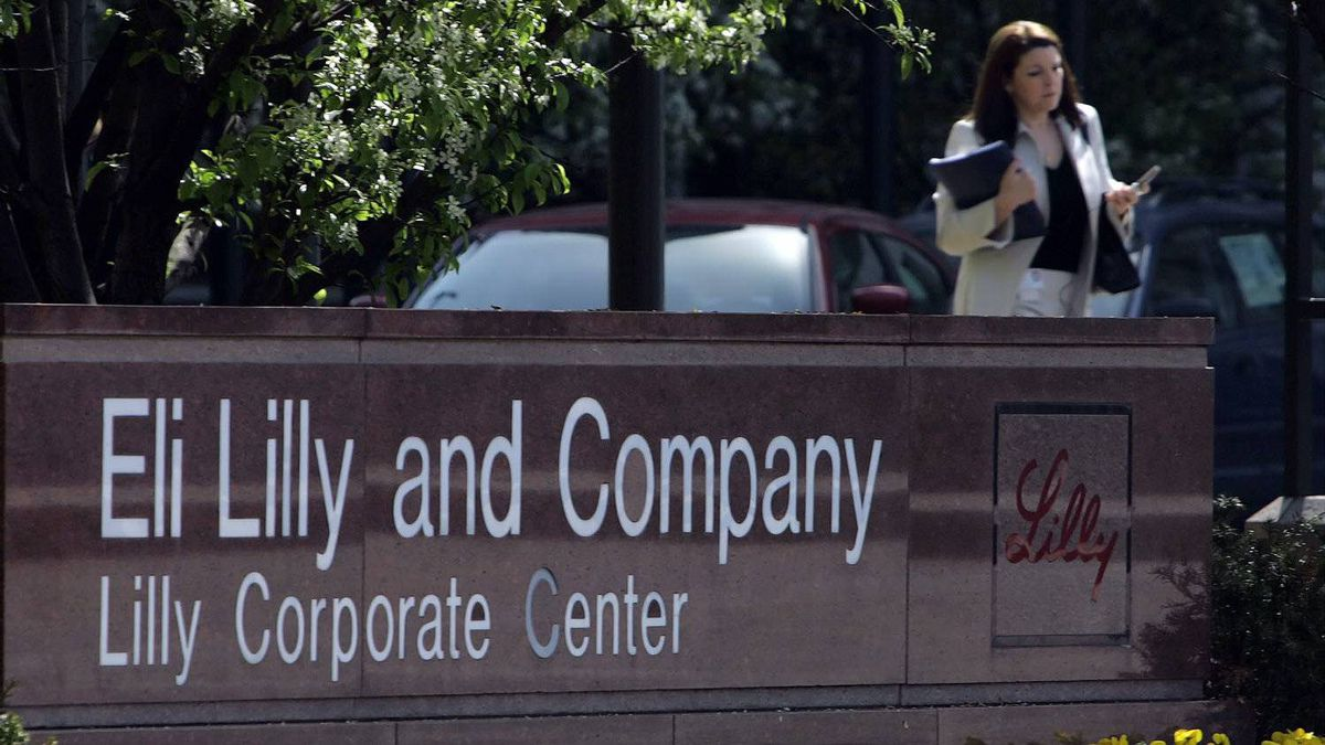 ** FILE ** A women leaves the Eli Lilly and Company campus in an Indianapolis file photo from April 18, 2006.