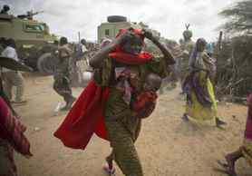 Women rush to a feeding centre after passing soldiers of the Transitional Federal Government (TGF) who try to contain the crowd at Badbaado, a new camp established by the TGF for internally displaced people, in the country's capital Mogadishu.