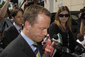 Michael Bryant, former Ontario Attorney-general, speaks to the media outside Toronto Police Services Monday.