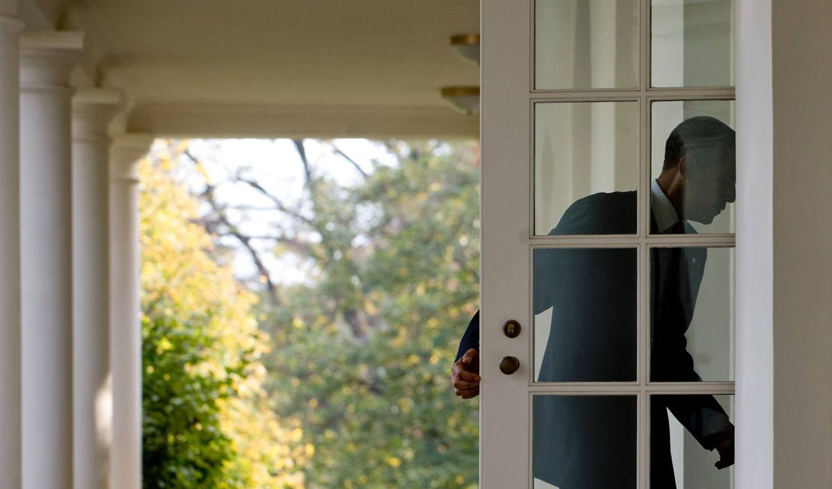 U.S. President Barack Obama walks into the cabinet room at the White House on Tuesday, November 3, 2009.