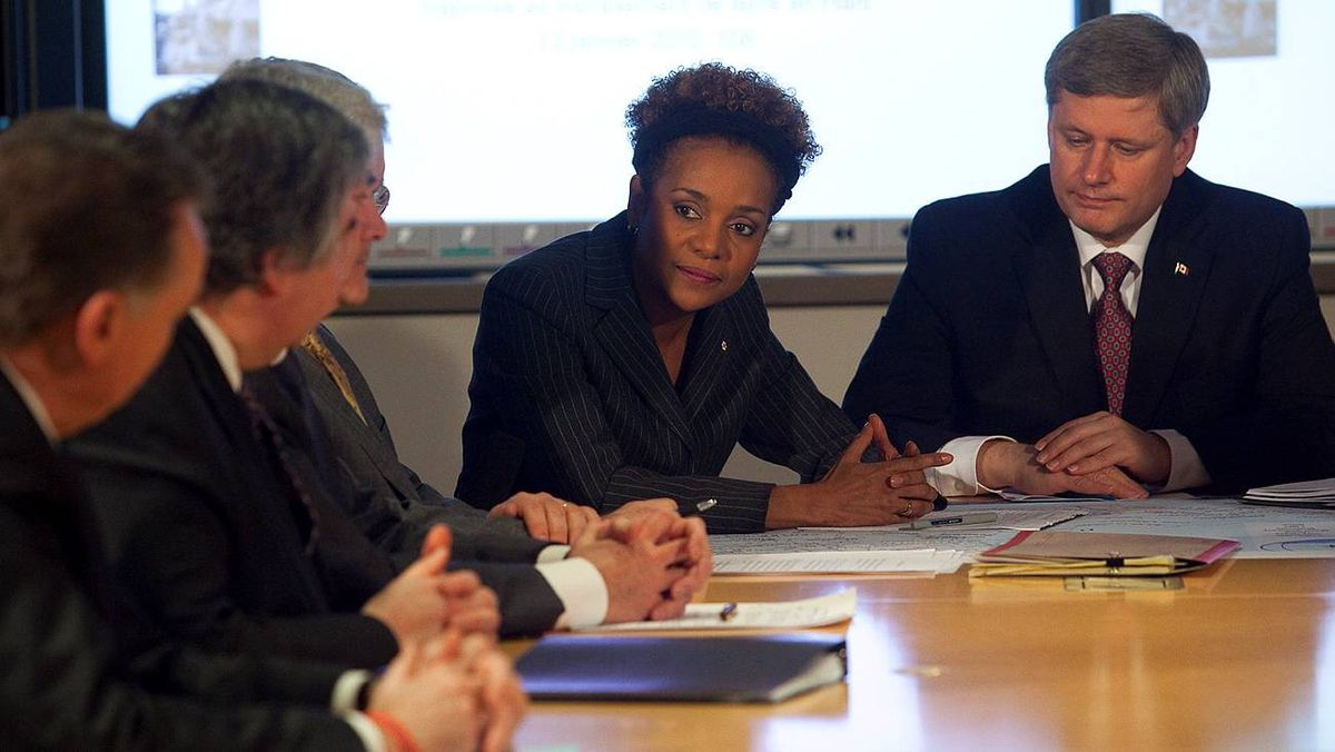 The Governor-General of Canada, Michaelle Jean, addresses Prime Minister Stephen Harper and other officials gathered for a briefing on the situation in Haiti at the department of Foreign Affairs in Ottawa on Jan. 13, 2010.