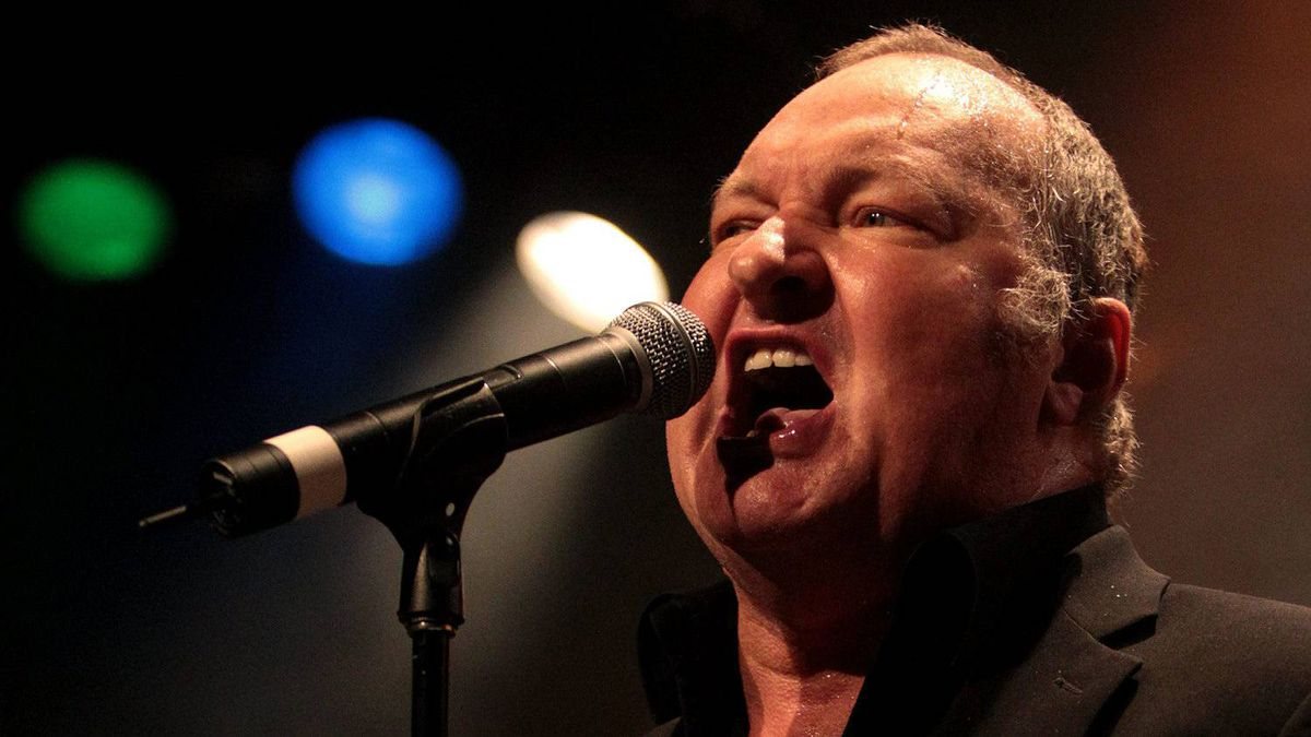 """U.S. actor Randy Quaid performs a song he's called """"Star Whackers"""" at the Commodore Ballroom as the opening act for local band The Town Pants in Vancouver, B.C., late Friday March 18, 2011."""