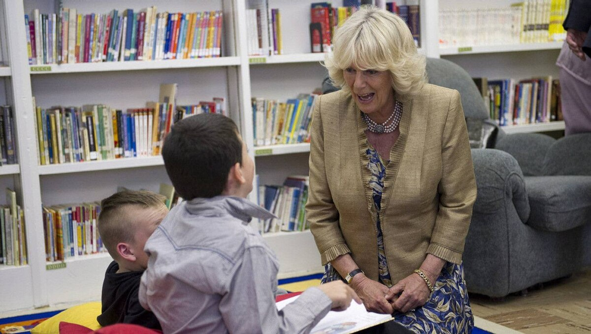 The Duchess of Cornwall chats with students reading in the library while touring the Hazen White-St Francis School in Saint John, N.B., on Monday, May 21, 2012. The royal couple are on a four-day visit to Canada to mark the Queen's Diamond Jubilee.
