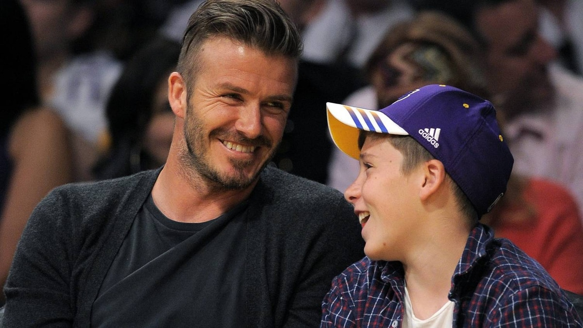 Soccer player David Beckham sits with his son Brooklyn as they watch the Los Angeles Lakers play the Denver Nuggets during an NBA first-round playoff basketball game, Sunday, April 29, 2012, in Los Angeles. The Lakers won 103-88. (AP Photo/Mark J. Terrill)