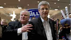 Prime Minister Stephen Harper and Toronto Mayor Rob Ford leave a campaign rally together in Brampton,Ontario on Friday April 29, 2011.