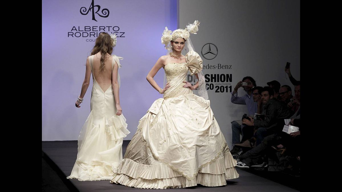 Models present creations by designer Rodriguez at the Mercedes-Benz DFashion show in Mexico City
