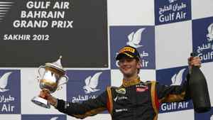 Romain Grosjean celebrates his third-place finish.