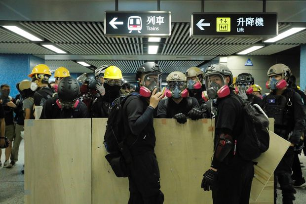 Image result for hong kong airport scene harass protests