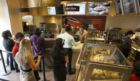 Customers line up to order Pastry's and coffee at Tim Hortons Coffee Shop in Dubai.