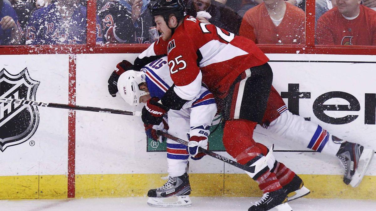 Ottawa Senators' Chris Neil (R) checks New York Rangers' Marc Staal during the third peroid of Game 6 of their NHL Eastern Conference quarter-final playoff hockey game in Ottawa, April 23, 2012. REUTERS/Chris Wattie