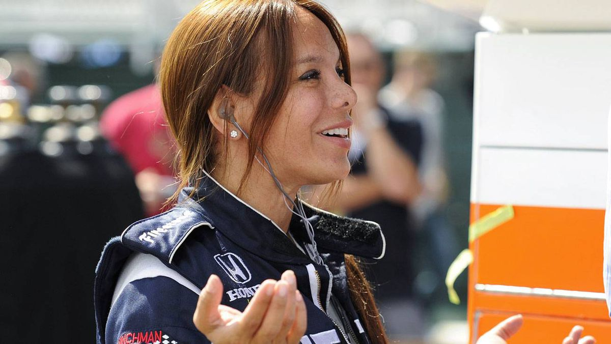 Dale Coyne Racing driver Milka Duno describes her crash to a teammate during the first day of the Indy Car Series practice at the Edmonton Indy in Edmonton, Alberta July 23, 2010.