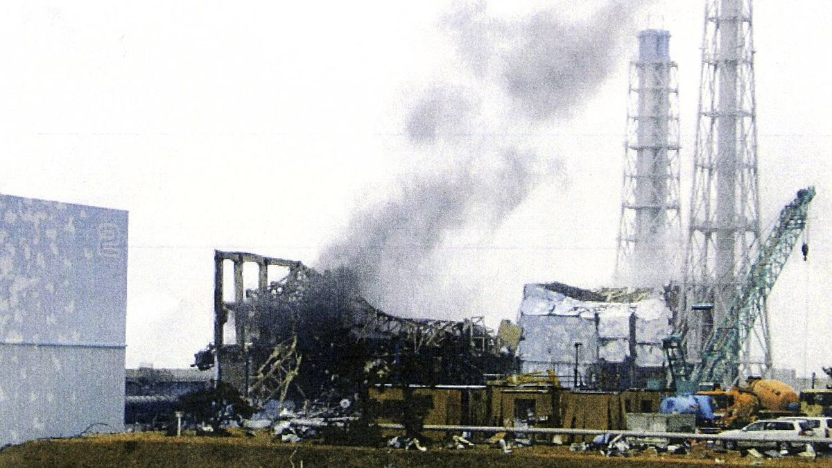 In this photo released by Tokyo Electric Power Co. (TEPCO) via Kyodo News, gray smoke rises from Unit 3 of the tsunami-stricken Fukushima Dai-ichi nuclear power plant in Okumamachi, Fukushima Prefecture, Japan, Monday, March 21, 2011. Official says TEPCO temporarily evacuated its workers from the site.