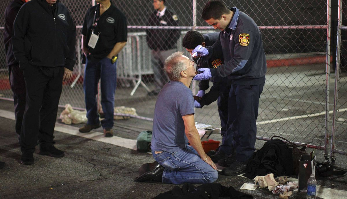 A man is treated for an unknown medical problem near the site of the 84th Academy Awards on Hollywood Boulevard in Hollywood, California late February 20, 2012.