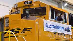 Prime Minister Stephen Harper waves from the cabin of an engine at Electro-Motive Diesel in London, Ont., on March 19, 2008.