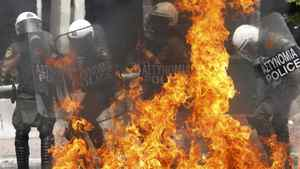 Riot police are engulfed in flames as they are hit with a molotov cocktail near the Greek parliament in Athens