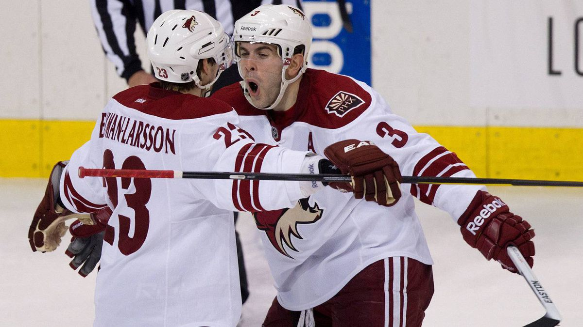 Phoenix Coyotes' Oliver Ekman-Larsson, left, of Sweden, and Keith Yandle celebrate Ekman-Larsson's goal against the Vancouver Canucks during the second period of an NHL hockey game in Vancouver, B.C., on Wednesday March 14, 2012.