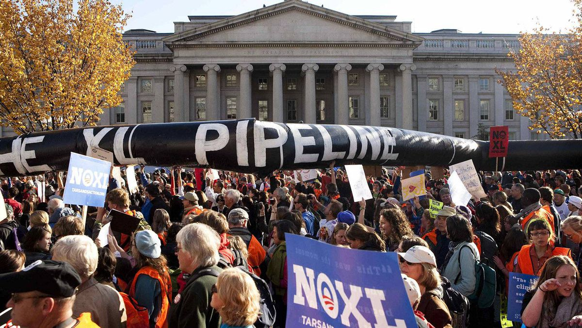 Demonstrators call for the cancellation of the Keystone XL pipeline during a November rally in Washington. President Barack Obama has since put the project on ice for further environmental study.