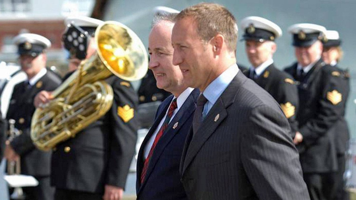 Defence Peter MacKay arrives at a naval ceremon in Halifax with Justice Minister Rob Nicholson on Aug. 16, 2011.