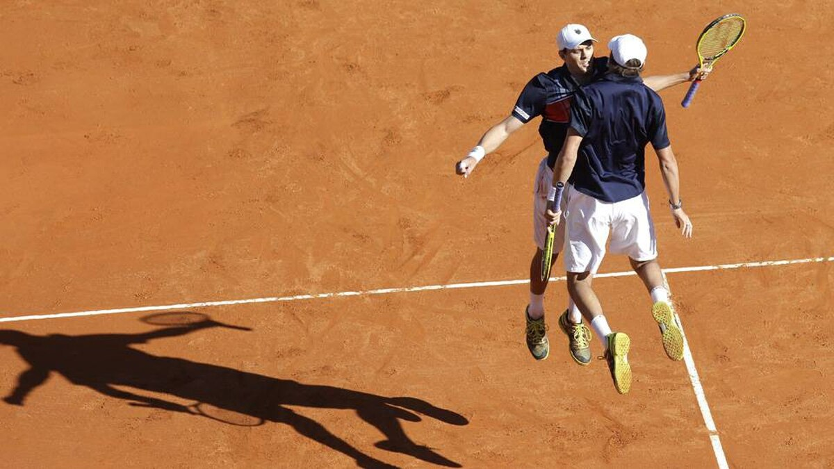Mike, left, and Bob Bryan reacts after defeating doubles Max Mirnyi of Bulgaria and Daniel Nestor of Canada in their final match of the Monte Carlo Tennis Masters tournament in Monaco, Sunday.