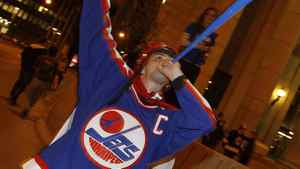 A hockey fan cheers at the corner of Portage and Main in downtown Winnipeg after media reports of the Atlanta Thrashers hockey team moving to Winnipeg, May 19, 2011. After years of false starts and false hope, hockey-obsessed Canada may finally reclaim its lost NHL team as speculation heated up this week that the league is set to return to Winnipeg 15 years after it left. REUTERS/Shaun Best