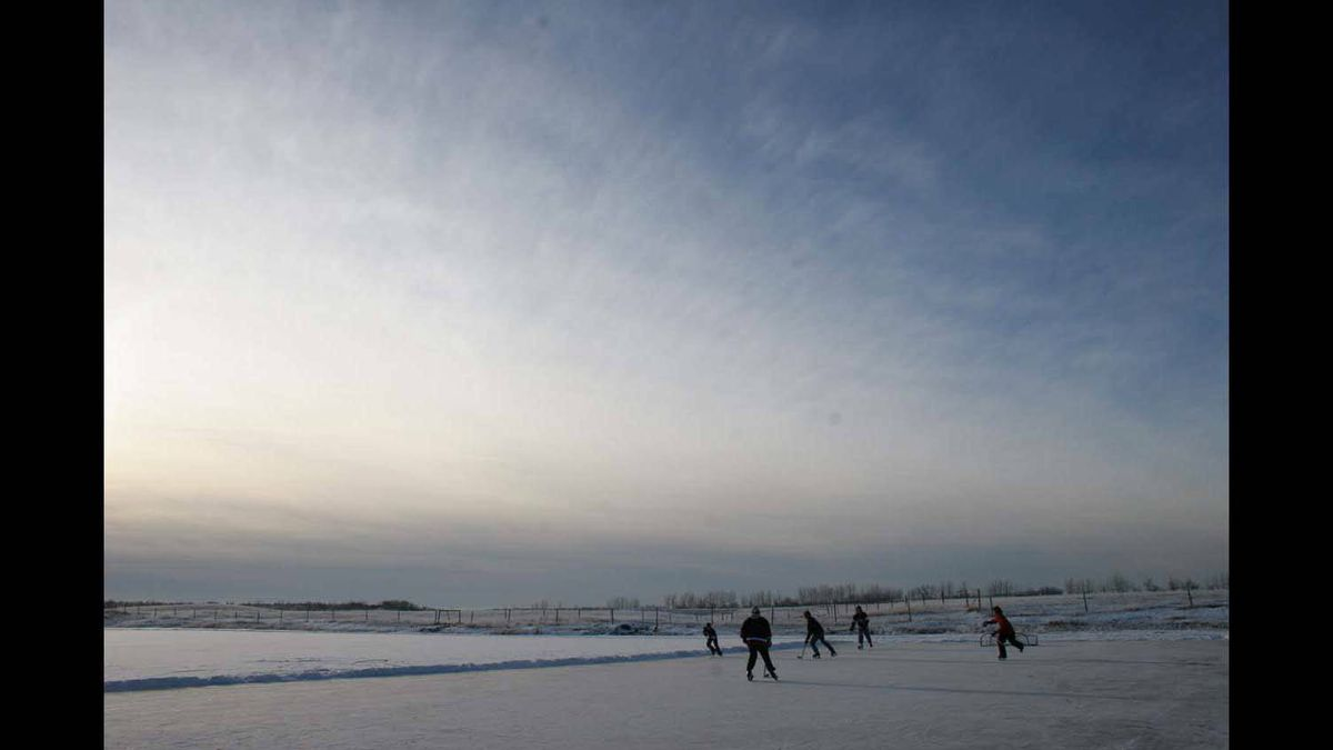 Boys from the rural neighbourhood of Goodwin east of Grande Prairie in northwest Alberta enjoy the country's national sport the way it should be played -- on a pond under prairie skies.