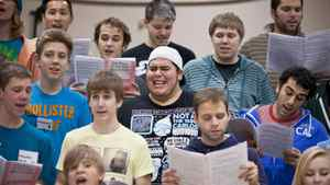 Nineteen-year-old Jason Diodati (wearing baseball cap) performs during a rehearsal with the Youth Singers of Calgary, a performing arts opportunity for young people based in Calgary, Alberta.