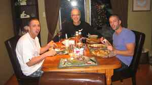 Scott Oake sits at the head of the table with sons Bruce, left, and Darcy. Bruce died of a drug overdose in March, 2011, when he was 25.