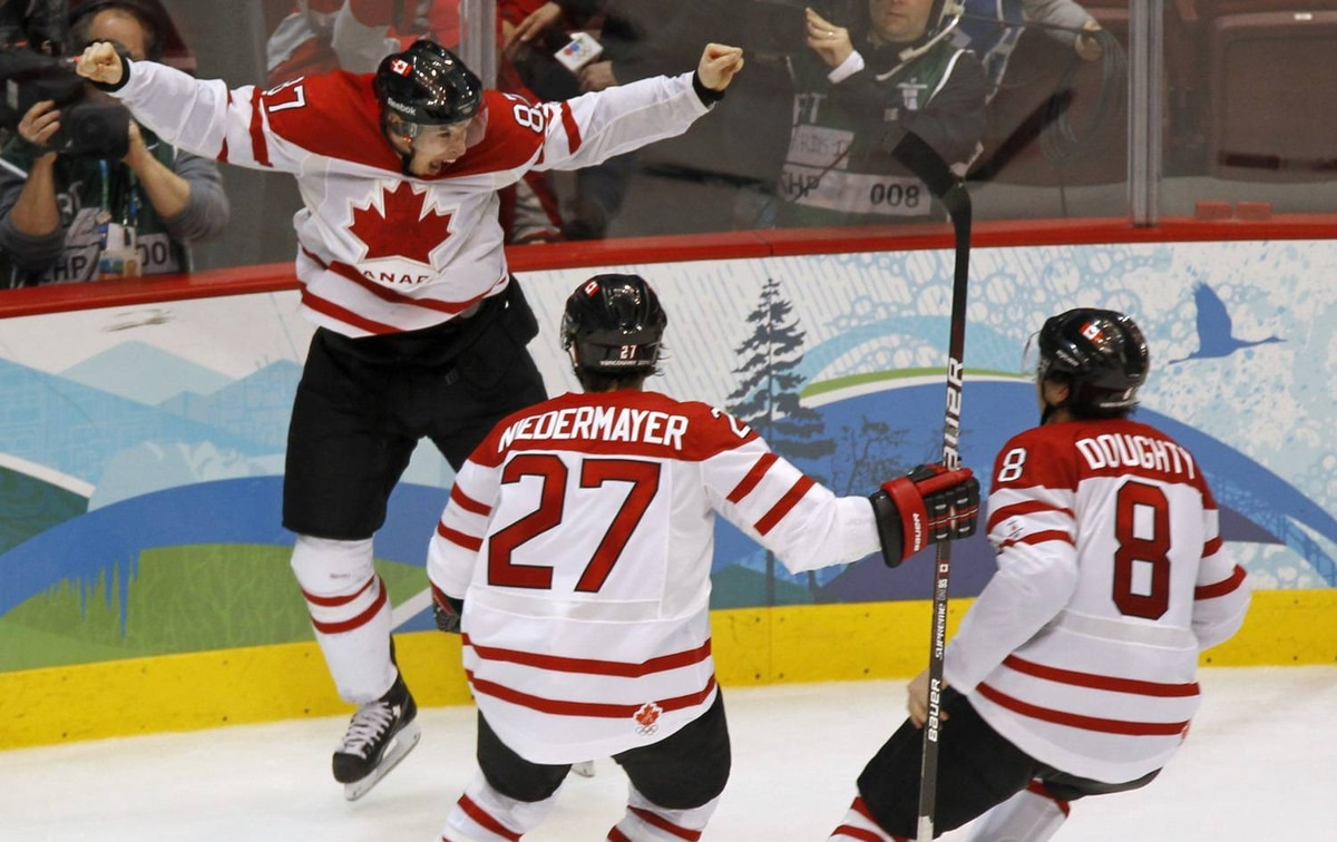Canada's Sidney Crosby celebrates his game winning goal with Scott Niedermayer and Drew Doughty during overtime period men's ice hockey gold medal final at the 2010 Winter Olympic Games in Vancouver, Sunday, Feb. 28, 2010.