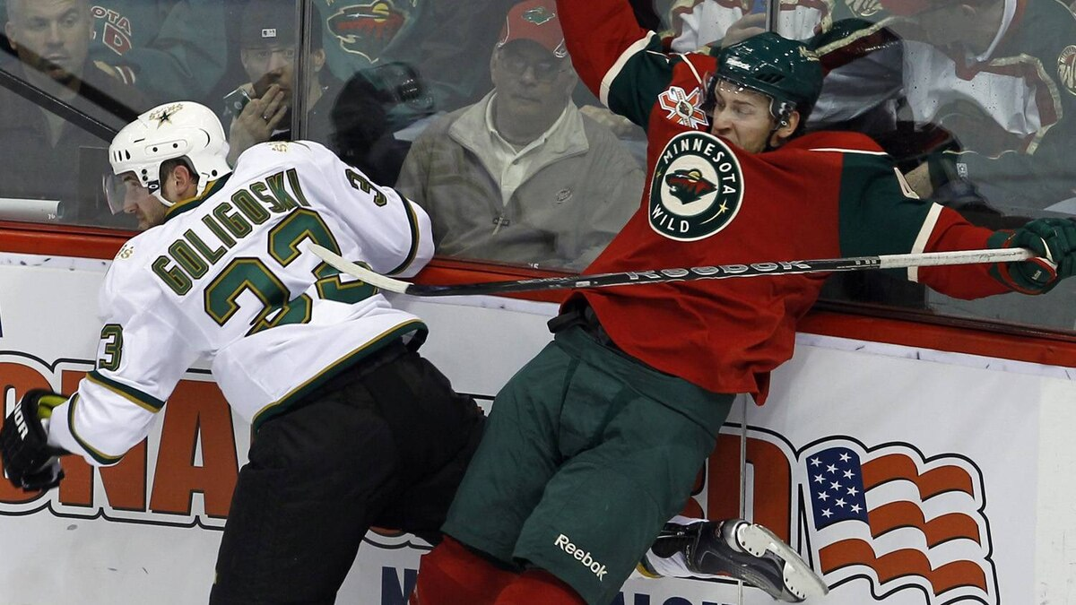 Minnesota Wild right wing Carson McMillan, right, and Dallas Stars defenseman Alex Goligoski (33) collide during the first period of an NHL hockey game in St. Paul, Minn., Sunday, April 10, 2011. The Wild won 5-3 and elimnated the Stars from the playoff race. (AP Photo/Ann Heisenfelt)