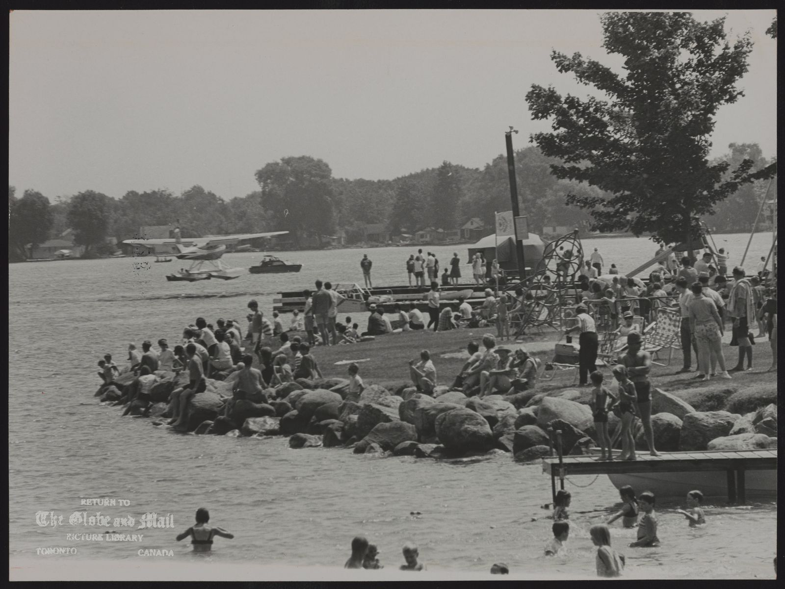 CHAMPLAIN PARK (Orillia) Holiday activities on Lake Couchiching at Champlain Park included flying, boating, swimming and sunning.