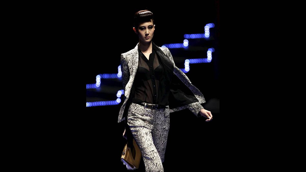 A model presents a creation for the LANCY 2011/2012 Autumn and Winter collection during China Fashion Week in Beijing