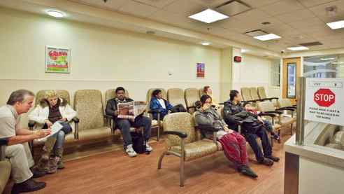 People wait to see a doctor in the Emergency/Trauma Unit waiting area at Sunnybrook Hospital on Dec. 5, 2010.