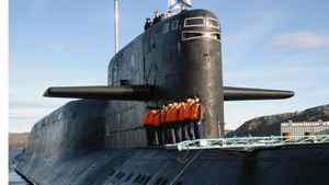 The crew of Russia's nuclear-powered submarine Yekaterinburg line up on its deck as it returns to Gadjiyevo base in Murmansk region, in this file photo taken September 26, 2006.