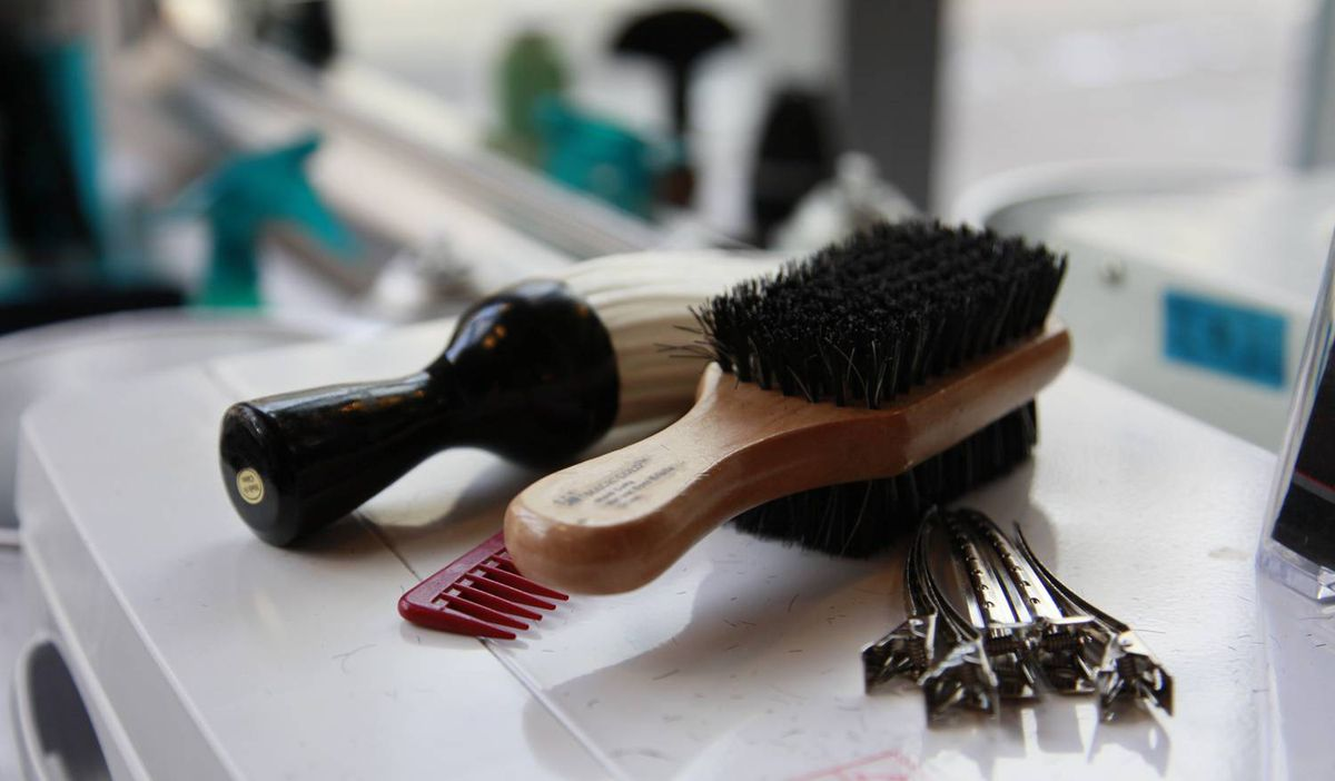 Brushes and combs on the counter of Mankind Grooming Studio