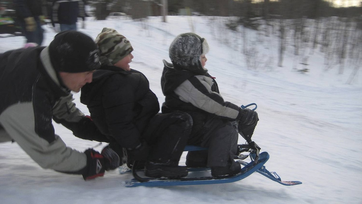 Scott Scarrow photo: Can we hit the jump? Date taken: Dec. 26, 2010 Russell (6) and Weston (4) Scarrow try out their new snow racer in McDougall (just outside Parry Sound) Ontario...