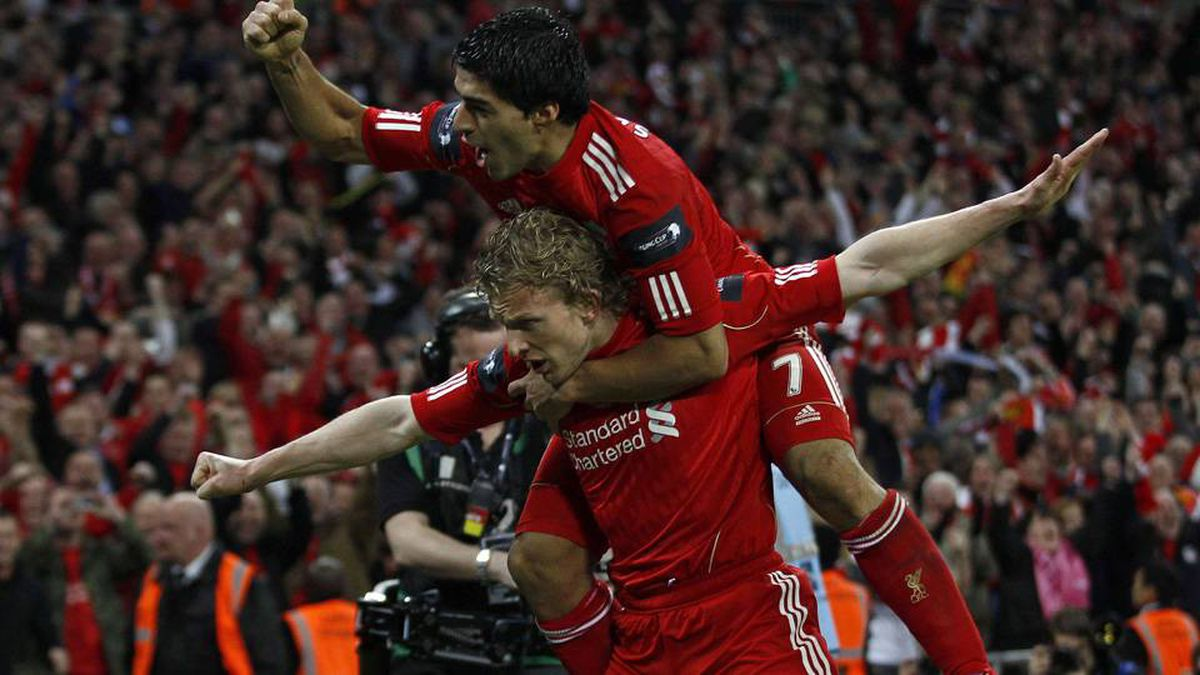 Liverpool's Dirk Kuyt, left, celebrates scoring with Luis Suarez against Cardiff City during their English League Cup final soccer match at Wembley Stadium in London on Sunday.