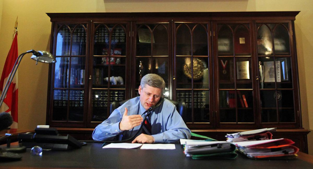Prime Minister Stephen Harper gives a radio interview in his Langevin Block office on Monday, January 18, 2010.