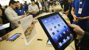 Customers look at the the new iPad at the Apple Store at the Toronto Eaton Centre shopping mall in Toronto March 16, 2012. The new iPad went on sale on Friday in 10 countries, including the United States, Canada, Singapore, France and Britain.