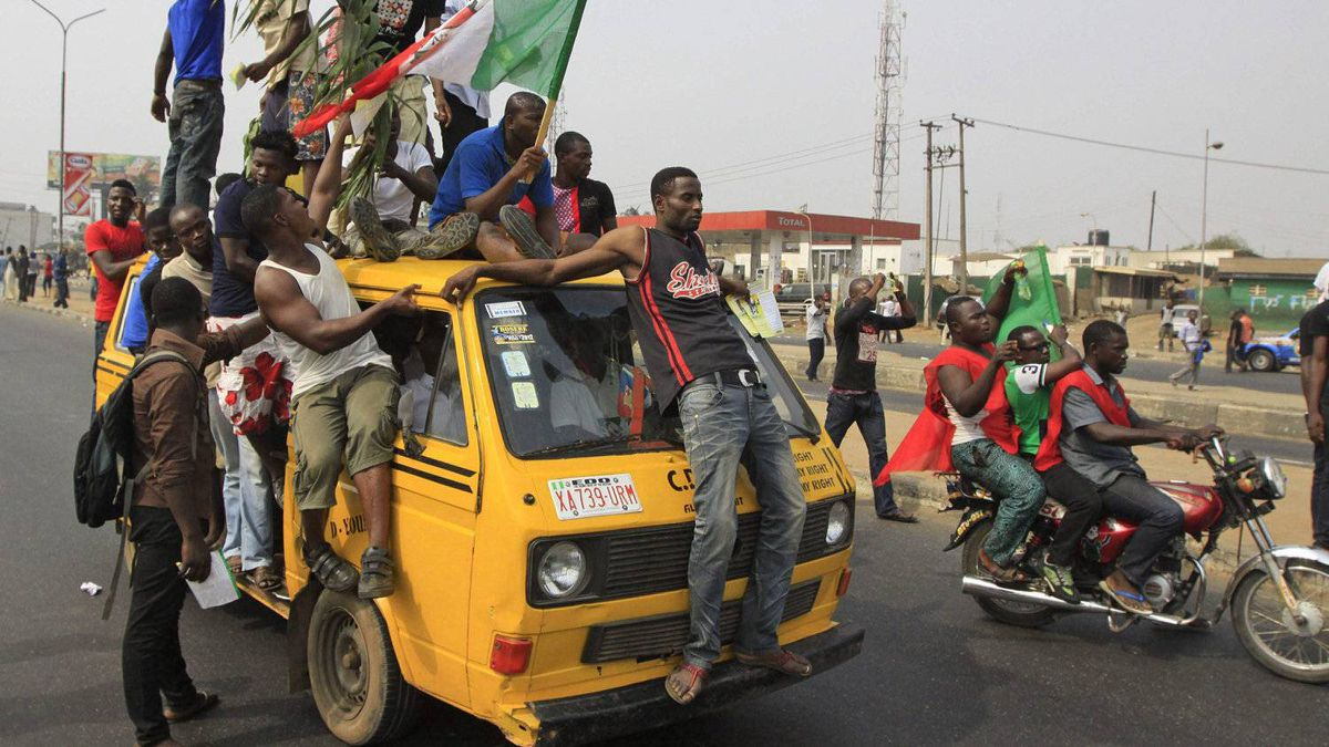 People take to the streets in protest following the removal of a fuel subsidy by the government in Lagos, Nigeria, Monday, Jan. 9, 2012. A national strike paralyzed much of Nigeria on Monday, with more than 10,000 demonstrators swarming its commercial capital to protest soaring fuel prices and decades of government corruption in the oil-rich country.