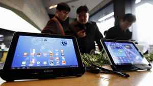 Customers look at Samsung Electronics' Galaxy Tab tablet computers at a store in Seoul on Jan. 17, 2012.