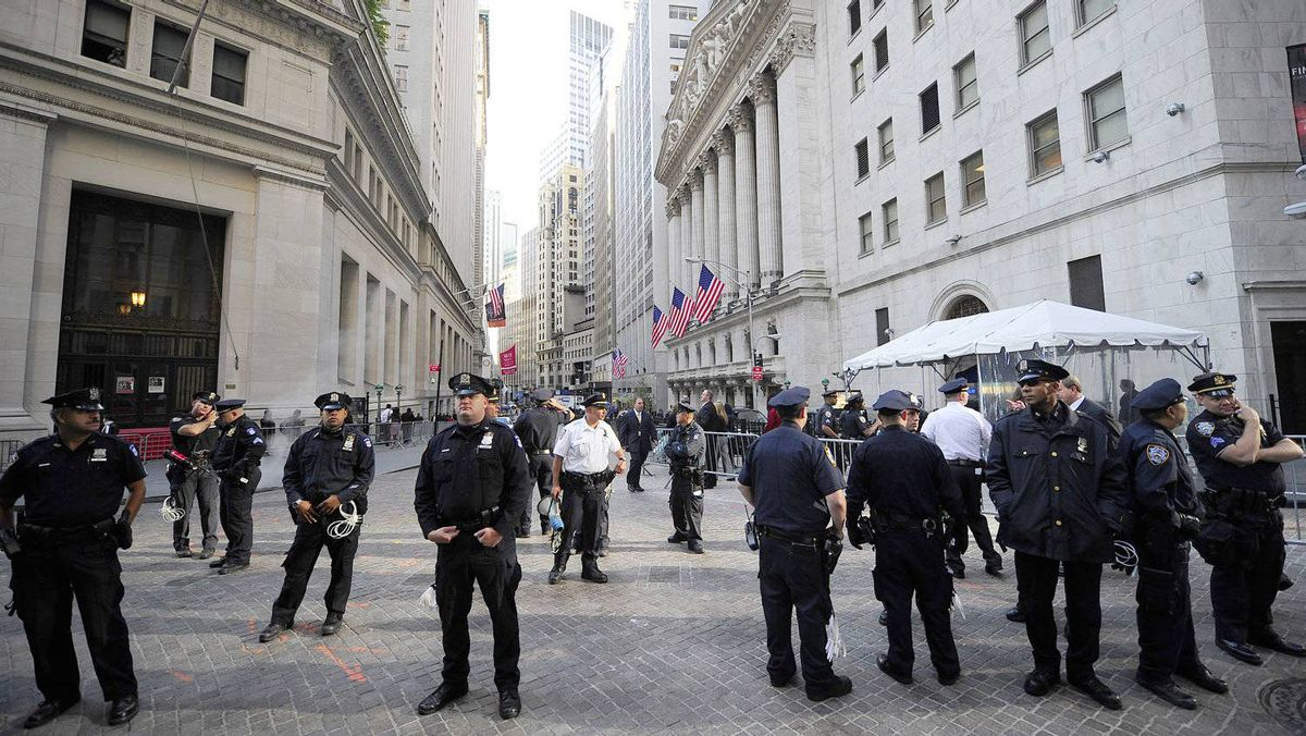 Policemen stand guard around the New York Stock Exchange as Participants in Occupy Wall Street demonstrate around Wall Street, in New York, September 19, 2011.